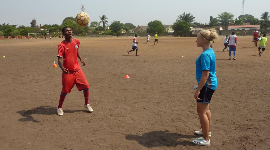 Projects Abroad High School volunteer practices football techniques in Ghana during her Football Coaching project.